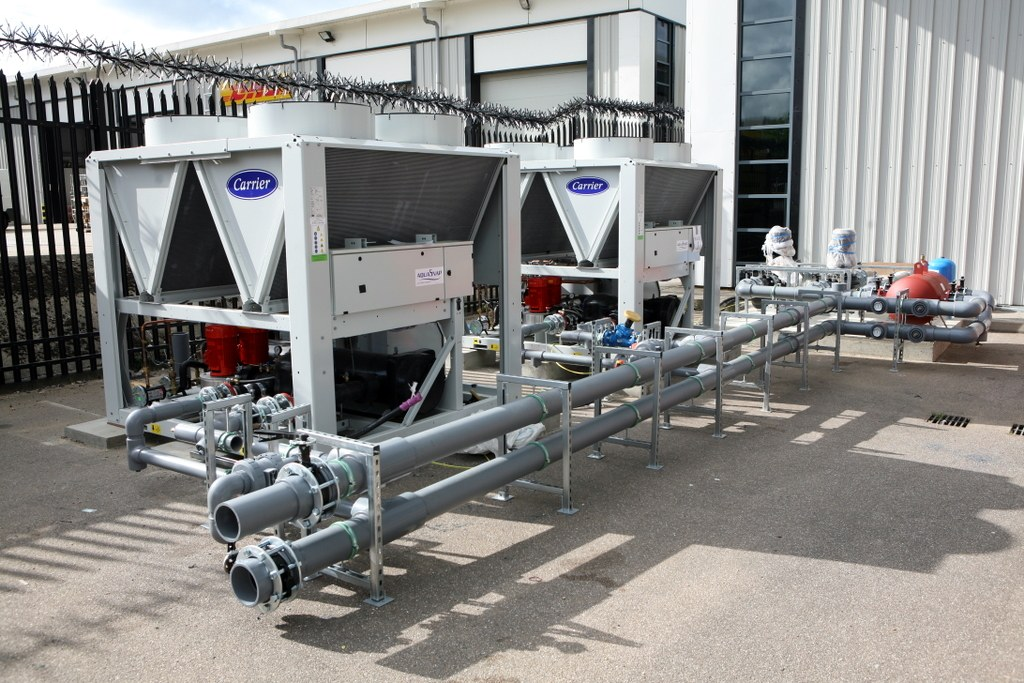 High efficiency packaged chillers, secure perimeter fence seen behind.
